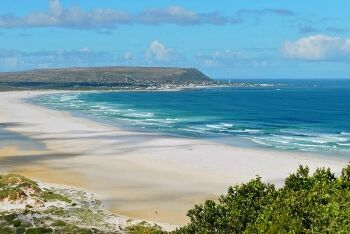 The beach at Noordhoek, with Kommetjie in the distance on Cape Town\'s South Peninsula